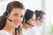 Beautiful businesswoman wearing headset