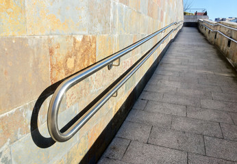 metal railings on slope of pedestrian walkway