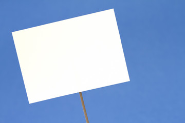 Blank white sign on a blue background