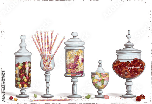 Set of chocolate candies in glass candy jars
