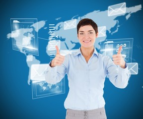 Composite image of businesswoman with the thumbs up