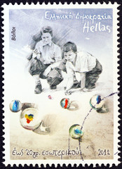 Children playing marbles (Greece 2012)