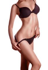 tan skin woman in black lingerie
