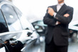 Choosing a car at dealership. - 60573962