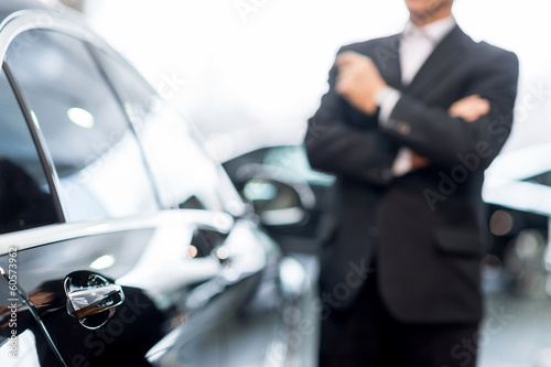 canvas print picture Choosing a car at dealership.