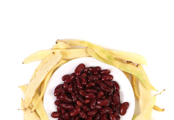 Composition of yellow pods and red beans.