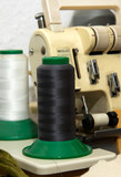 Closeup to vintage sewing machine and thread spool - 60576775