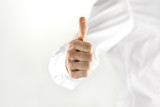 Motivated man giving a thumbs up sign