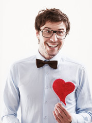 Happy Romantic man with a red heart in his hand