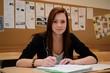 canvas print picture - Schuelerin macht sich Notizen