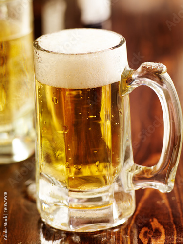 large mug of beer on wood counter