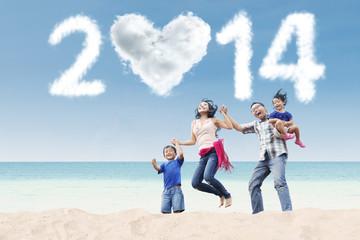 Happy family celebrate new year 2014 at beach