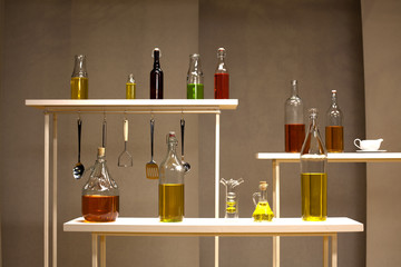 olive oil into different bottles on a shelf against