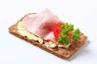 Brown crisp bread with ham