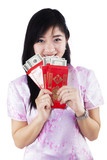 Woman holding red packet gift