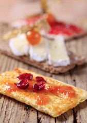 Crispbread with marmalade, cheese and jam