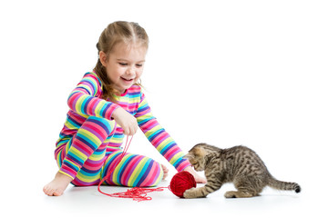 child girl playing with kitten isolated on white background