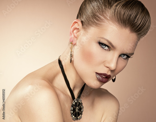 Glamour girl with professional makeup wearing black necklace