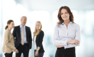 Beautiful businesswoman standing in office