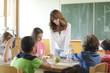 Teacher In Classroom - 60582163
