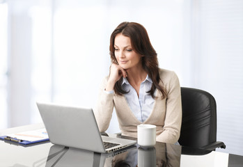 Professional businesswoman working on laptop