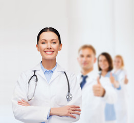 smiling female doctor with stethoscope