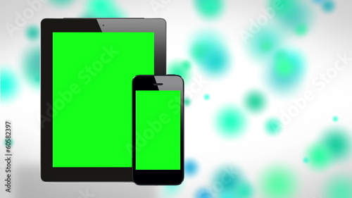 Tablet and smartphone on cool background. Green screen