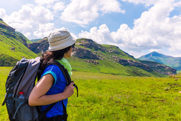 Female tourist hiking in mountains.