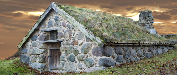 stone cabin with grass roof