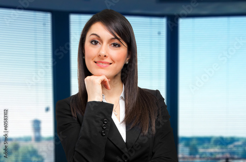 Smiling businesswoman in the office