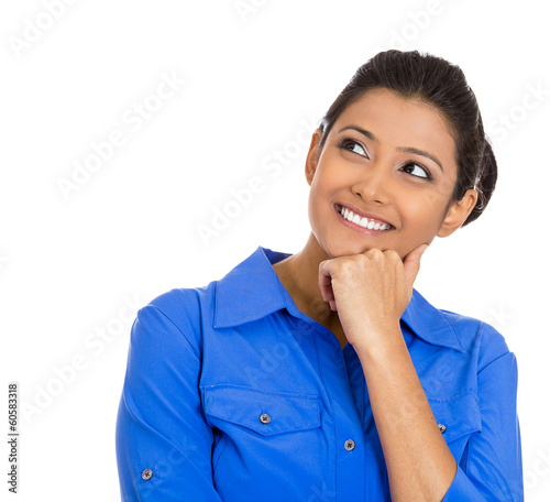 Smiling young woman, student thinking, daydreaming