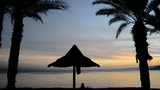 Silhouettes on the golden beach of the Red Sea, Eilat