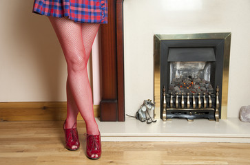 Woman in short skirt with red fishnet tights