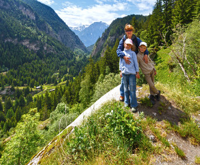 Family in summer Alps mountain (Switzerland).