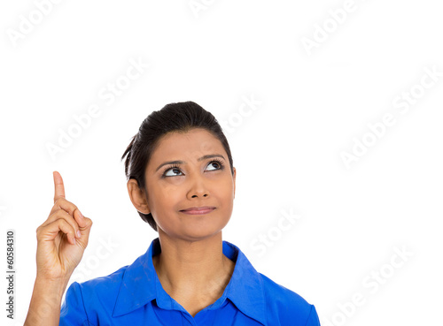 Woman pointing with index finger up having the right answer