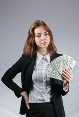 businesswoman with wad of money in her hands