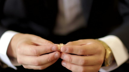 Man holding two wedding rings in his hands
