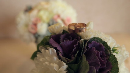 Beautiful wedding bouquet with cabbage leaves and rings