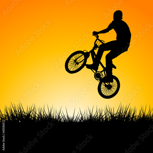 Silhouette of a biker jumping in the sunset