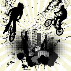 Grunge background with two bikers and city skyline over sunburst