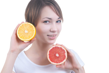 Girl holding the half of lemon and grapefruit