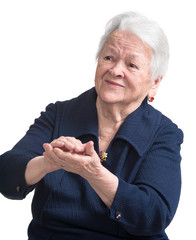 Old woman smiling and applauding