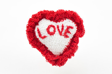 handmade heart knitted made from yarn and with word love