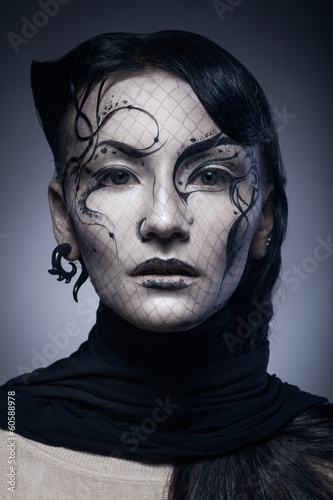 portrait of young gothic woman isolated on dark background