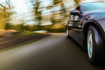 Luxury sedan speeding.