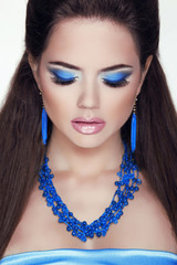 Closeup woman portrait. Jewelry. Eye makeup, professional visage