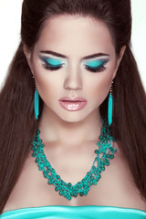 Makeup. Jewelry. Glamour Fashion Beauty Woman Portrait. Closeup