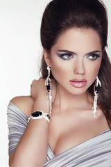 Beautiful woman with jewelry fashion accessories. Make-up. Beaut