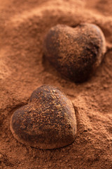 Chocolate hearts covered in cocoa powder
