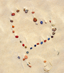 Heart of stones in the desert - Stones in the sand, background